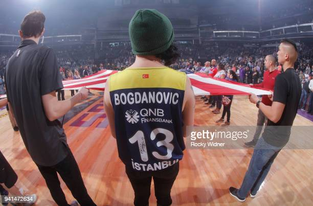 A fan of Bogdan Bogdanovic of the Sacramento Kings holds up the American flag during the national anthem of the game against the Dallas Mavericks on...