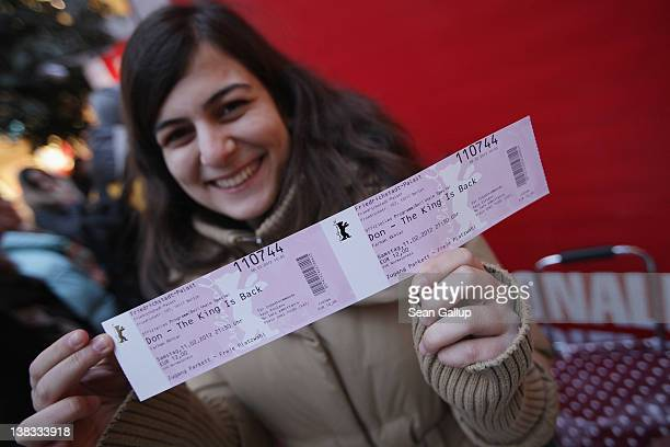 A fan of Bollywood actor Shah Rukh Khan holds up tickets she bought for the Berlinale premiere of 'Don The King Is Back' on the first day of ticket...