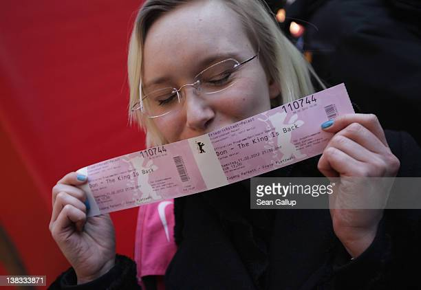 A fan of Bollywood actor Shah Rukh Khan kisses tickets she bought for the Berlinale premiere of 'Don The King Is Back' on the first day of ticket...