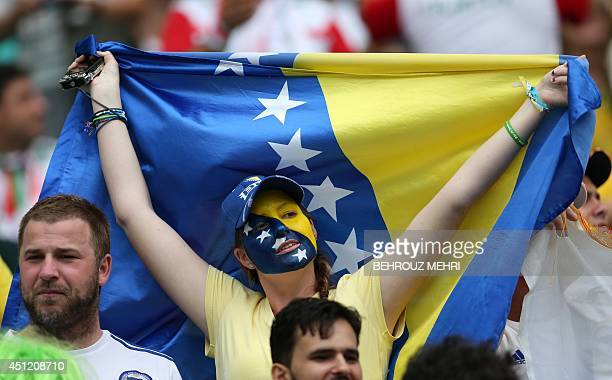 A fan of BosniaHercegovina reacts during a Group F football match between BosniaHercegovina and Iran at the Fonte Nova Arena in Salvador during the...
