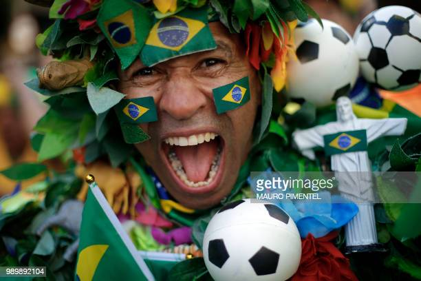 Fan of Brazil celebrates Brazil's victory over Mexico after watching the World Cup match on a big screen set on Alzira Brandao street in northern Rio...