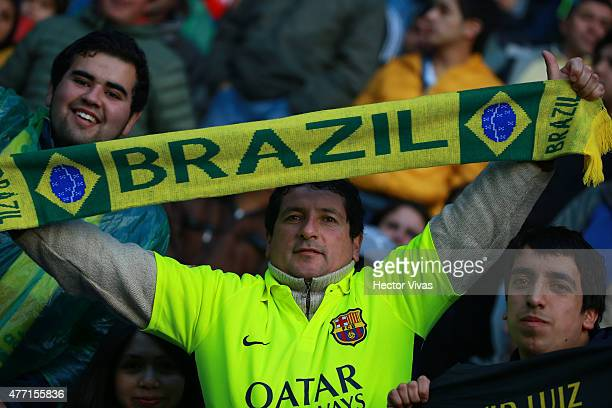 A fan of Brazil enjoys the atmosphere prior the 2015 Copa America Chile Group C match between Brazil and Peru at Municipal Bicentenario Germán Becker...