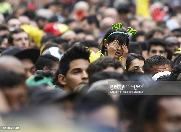 A fan of Brazil gestures at the Fan Fest public viewing event in Sao Paulo Brazil for the start of the FIFA World Cup semifinal football match...