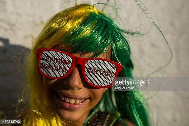 A fan of Brazil poses for pictures during the FIFA Fan Fest for the opening game of the FIFA World Cup 2014 between Brazil and Croatia at Praia Do...