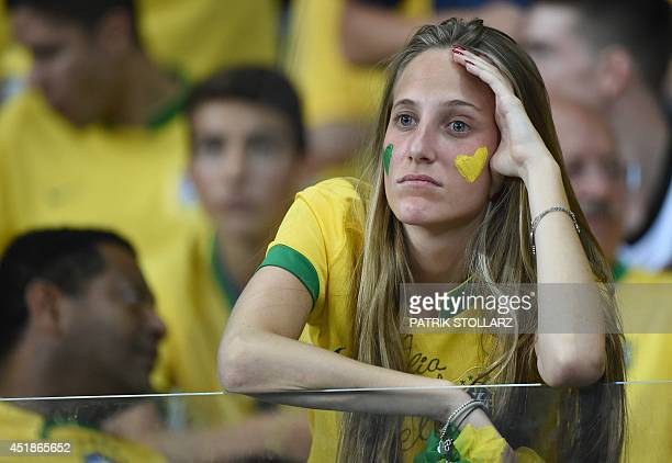A fan of Brazil reacts during the semifinal football match between Brazil and Germany at The Mineirao Stadium in Belo Horizonte during the 2014 FIFA...