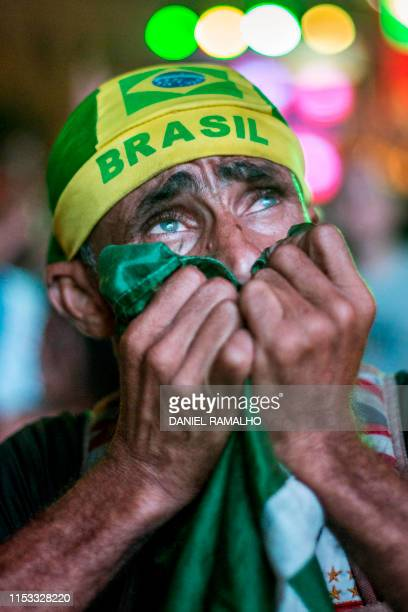 A fan of Brazil reacts while attending the broadcasting of the Copa America tournament semifinal football match between Argentina and Brazil at the...