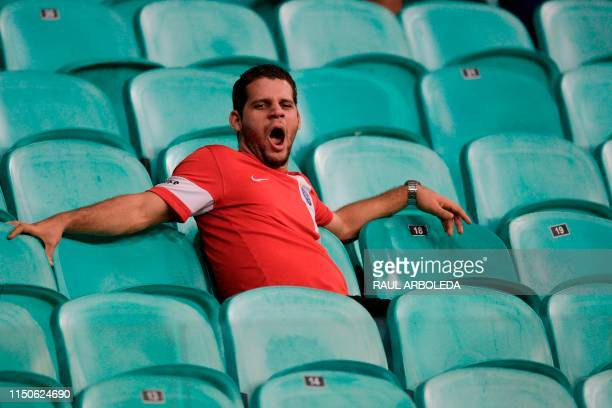 A fan of Brazil yawns on the stands after the team tied 00 with Venezuela in a Copa America football tournament group match at the Fonte Nova Arena...