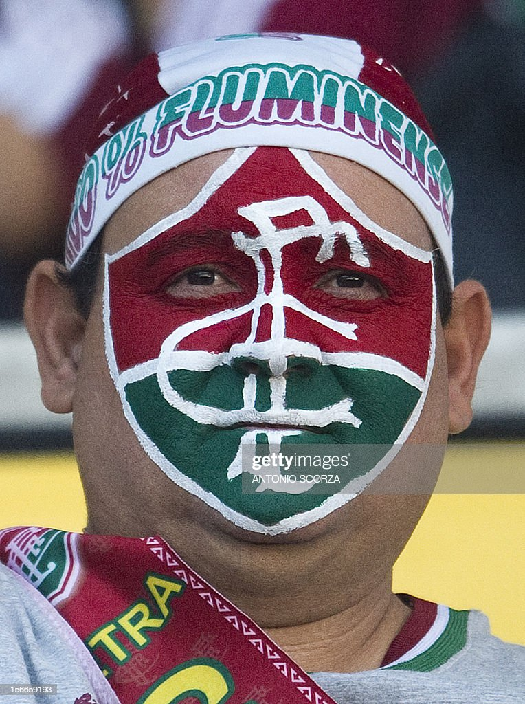 A fan of Brazilian football team Fluminense cheers before the start of the match against Cruzeiro for the Brazilian football Championship -- which was won by the team the past weekend -- at the Joao Havelange stadium in Rio de Janeiro on November 18, 2012.