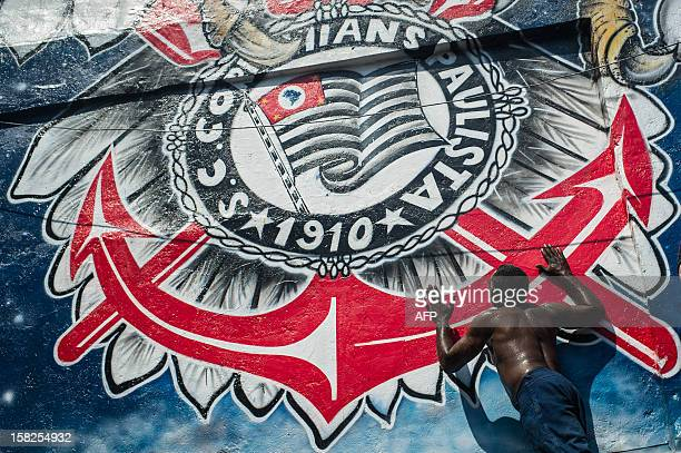 A fan of Brazil's Corinthians kisses a giant emblem of the team as he celebrates in Sao Paulo Brazil after Corinthians won the 2012 Club World Cup...