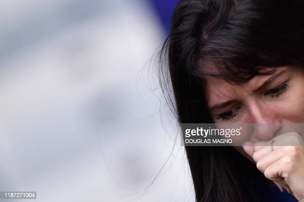 A fan of Brazil's Cruzeiro cries at the end of the Brazilian Championship football match against Palmeiras in Belo Horizonte Brazil on December 8...