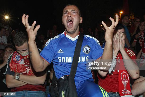 A fan of Chelsea celebrates his team's victory of the UEFA Champions League final between FC Bayern Muenchen and Chelsea FC as Bayern Muenchen fans...