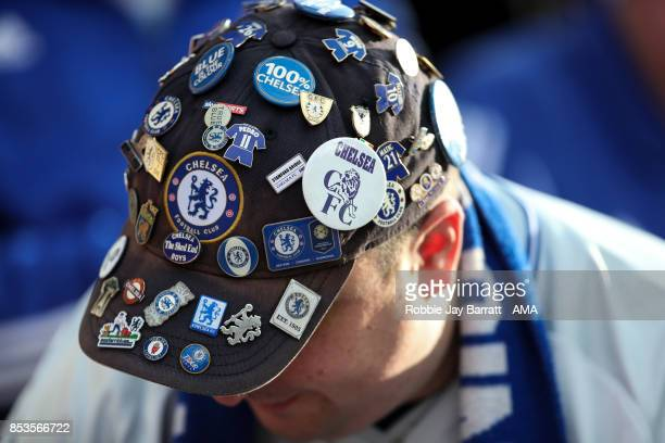 A fan of Chelsea wears a cap covered in Chelsea pin badges during the Premier League match between Stoke City and Chelsea at Bet365 Stadium on...