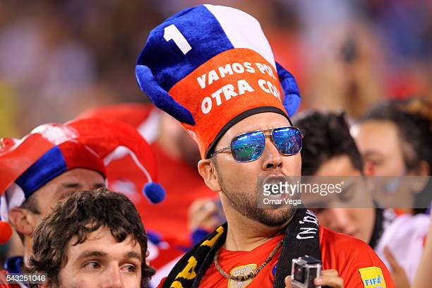 A fan of Chile cheer for his team during the championship match between Argentina and Chile at MetLife Stadium as part of Copa America Centenario US...