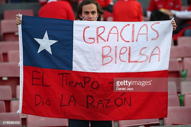A fan of Chile displays a Chilean flag in support of Marcelo Bielsa former coach of the Chilean national football team prior to to the 2015 Copa...