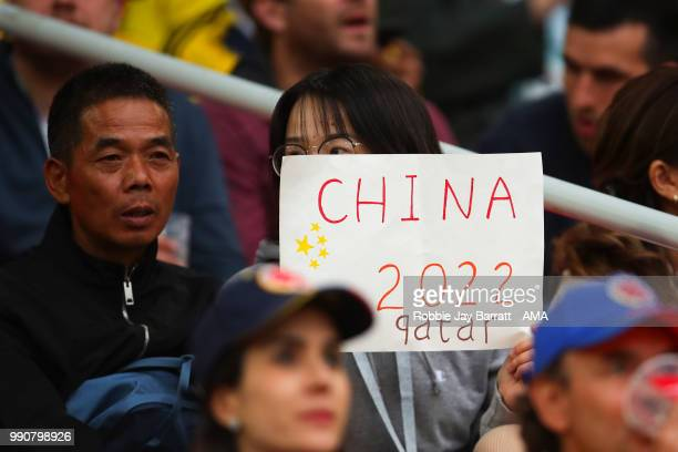 A fan of China looks on with a banner prior to the 2018 FIFA World Cup Russia Round of 16 match between Colombia and England at Spartak Stadium on...