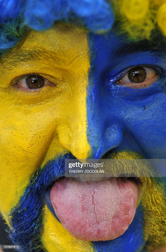 A fan of Clermont Ferrand's rugby attends the outdoor screening of the Top 14 final between Perpignan and Clermont Ferrand on May 29, 2010 in Clermont Ferrand, center France.