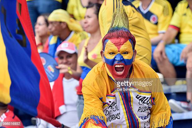 A fan of Colombia cheers for his team during a match between Colombia and Venezuela as part of FIFA 2018 World Cup Qualifiers at Roberto Melendez...