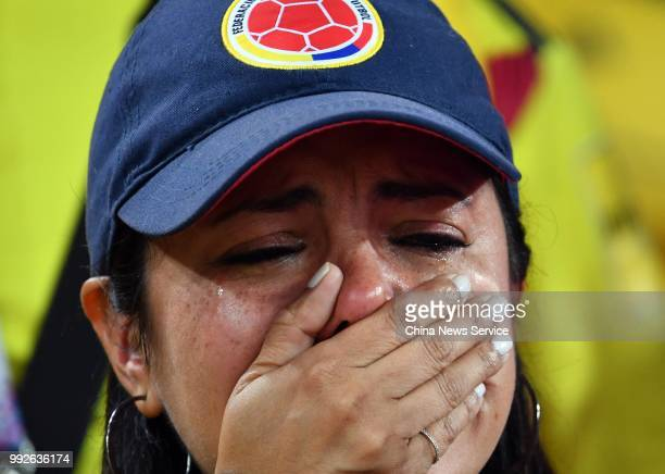 A fan of Colombia looks dejected during the 2018 FIFA World Cup Russia Round of 16 match between Colombia and England at the Spartak Stadium on July...