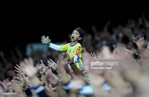 A fan of Corinthians celebrates during a match between Corinthians and Cerro Porteno as part of Group 8 of Copa Bridgestone Libertadores at Arena...