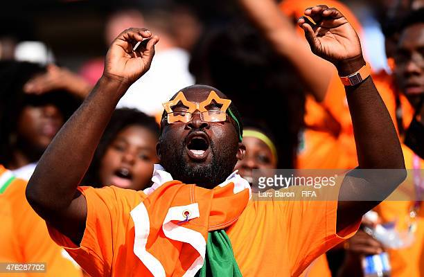 A fan of Cote D'Ivoire celebrates during the FIFA Women's World Cup 2015 Group B match between Germany and Cote D'Ivoire at Lansdowne Stadium on June...