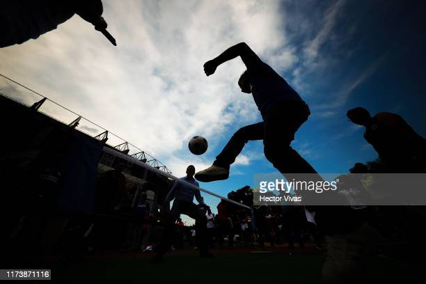 Fan of Cruz Azul plays football outside Azteca stadium prior the 13th round match between Cruz Azul and America as part of the Torneo Apertura 2019...