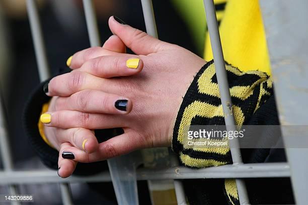 A fan of Dormtund prays prior to the 1 Bundesliga match between Borussia Dortmund an Borussia Moenchengladbach at Signal Iduna Park on April 21 2012...