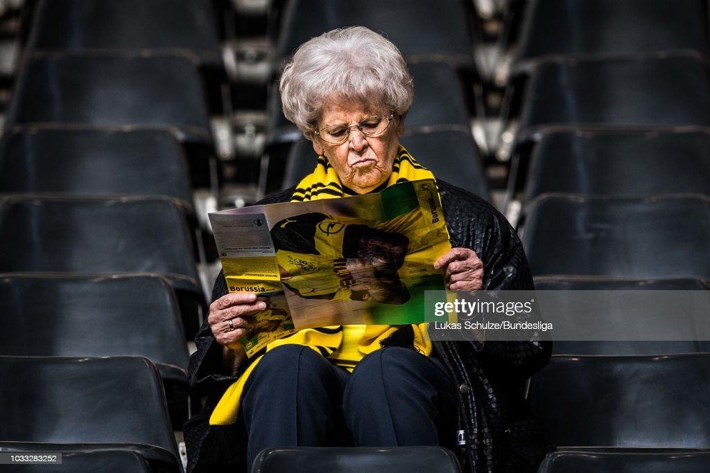 A fan of Dortmund reads a paper prior to the Bundesliga match between Borussia Dortmund and Eintracht Frankfurt at Signal Iduna Park on September 14, 2018 in Dortmund, Germany.