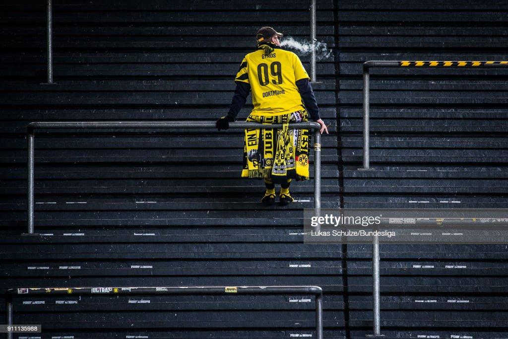 A fan of Dortmund stays on the tribune prior to the Bundesliga match between Borussia Dortmund and Sport-Club Freiburg at Signal Iduna Park on January 27, 2018 in Dortmund, Germany.