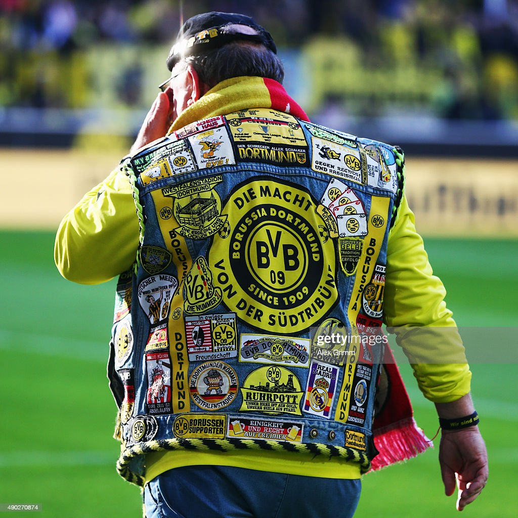 A fan of Dortmund walks along the pitch prior to the Bundesliga match between Borussia Dortmund and SV Darmstadt 98 at Signal Iduna Park on September 27, 2015 in Dortmund, Germany.