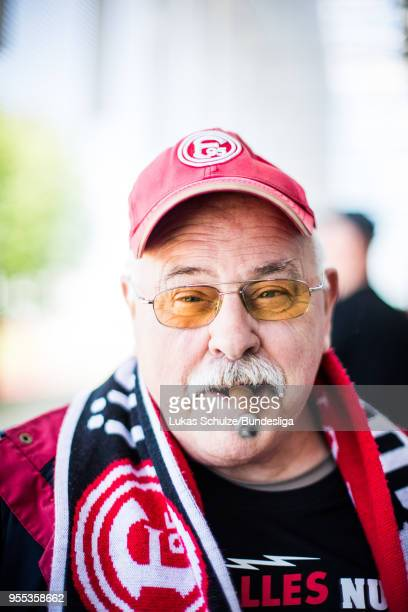 Fan of Duesseldorf poses with his cigar prior to the Second Bundesliga match between Fortuna Duesseldorf and Holstein Kiel at Esprit-Arena on May 6,...