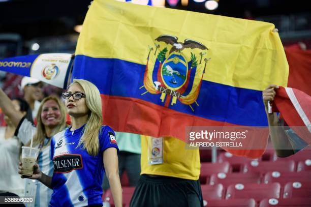 A fan of Ecuador holds a flag before the start of the Copa America Centenario football tournament match in Glendale Arizona United States on June 8...