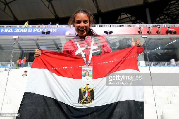 A fan of Egypt holds an Egyptian flag during the 2018 FIFA World Cup Russia Group A match between Saudi Arabia and Egypt at the Volgograd Arena in...