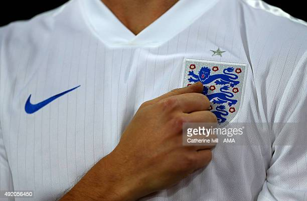 A fan of England places his hand on the badge on his shirt before the UEFA EURO 2016 Qualifier match between England and Estonia at Wembley Stadium...