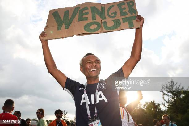 A fan of England show his banner with words 'Wenger Out' before the 2018 FIFA World Cup Russia Semi Final match between England and Croatia at...