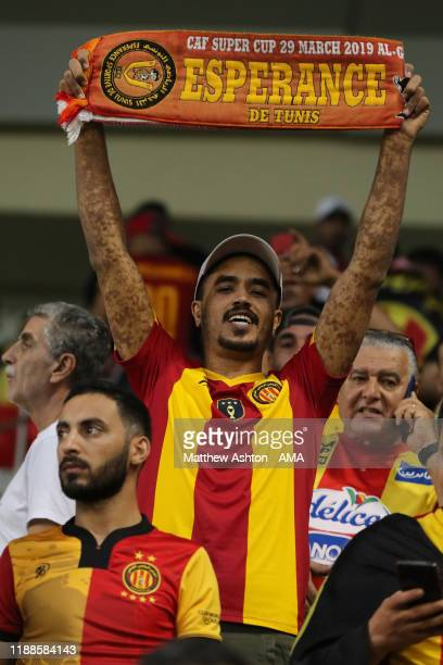 A fan of Esperance Sportive de Tunis holding up a scarf from the 2019 CAF Super Cup during the FIFA Club World Cup 2nd round match between Al Hilal...