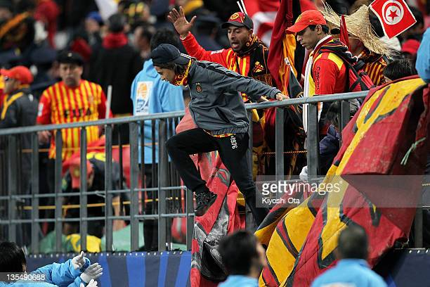 A fan of Esperance Sportive de Tunis reacts after the team lost the FIFA Club World Cup Quarter Final match between Esperance Sportive De Tunis and...