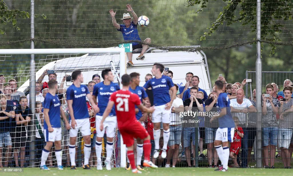 A fan of Everton sits on a car and tries to catch a free kick of Danny Holla of Twente during a preseason friendly match between FC Twente and Everton FC at Sportpark de Stockakker on July 19, 2017 in De Lutte, Netherlands.