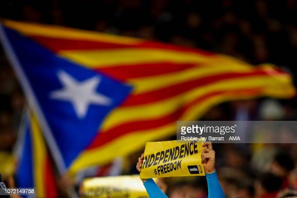 A fan of FC Barcelona holds up a banner in protest for the independence of Catalonia during the UEFA Champions League Group B match between FC...