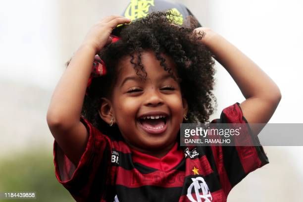 A fan of Flamengo football club takes part in a celebration parade following the team's arrival after their Libertadores final match victory over...