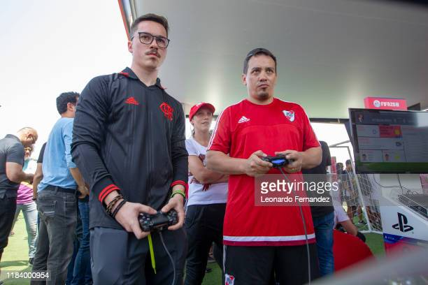 Fan of Flamengo plays a Playstation game against a fan of River Plate ahead of the final match of Copa CONMEBOL Libertadores 2019 on November 22,...
