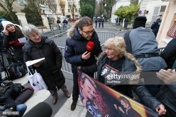 A fan of French singer and actor Johnny Hallyday holds a portrait of him near his house in MarneslaCoquette on December 6 2017 France's bestknown...