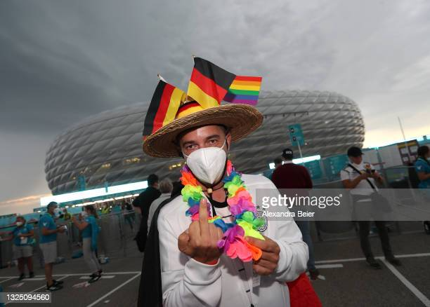 Fan of Germany covered with Germa flags and rainbow flags gestures in front of the Allianz Arena soccer stadium ahead of the Euro 2020 Group F match...