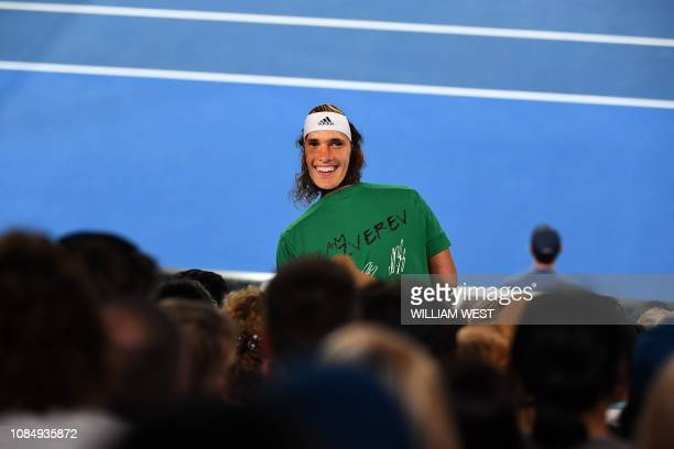 A fan of Germany's Alexander Zverev cheers as he plays against Australia's Alex Bolt during their men's singles match on day six of the Australian...