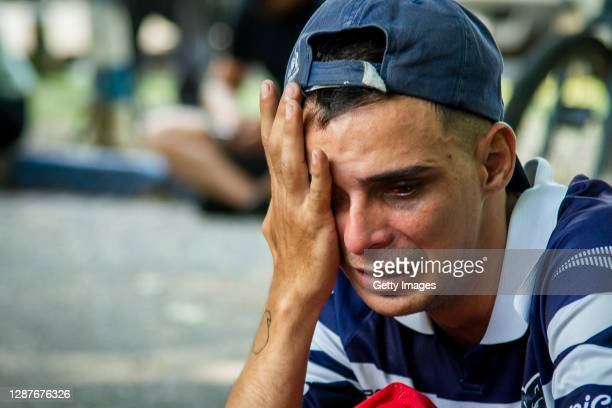 Fan of Gimnasia y Esgrima La Plata cries after the news of the death of Diego Maradona was known at Juan Carmelo Zerillo Stadium on November 25, 2020...