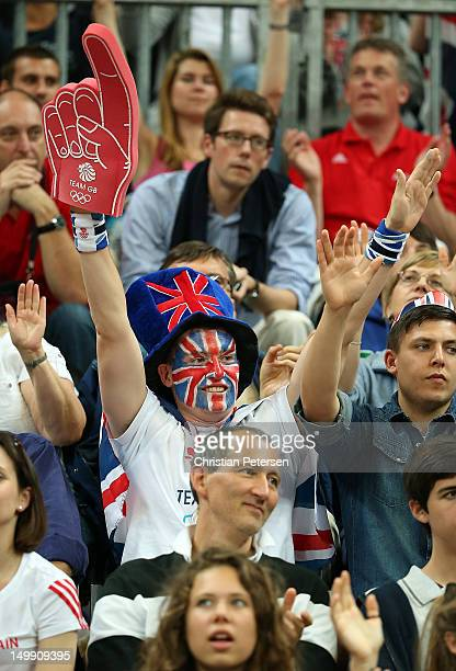 A fan of Great Britain cheers during the Men's Basketball Preliminary Round match against China on Day 10 of the London 2012 Olympic Games at the...
