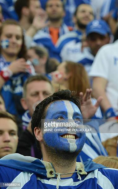 A fan of Greece's national football team smiles ahead of the Euro 2012 football championships quarterfinal match Germany vs Greece on June 22 2012 at...