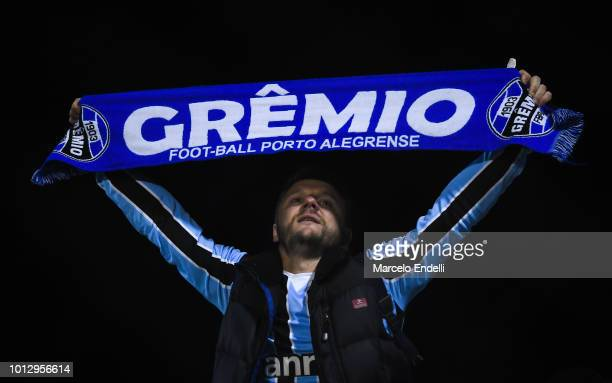 Fan of Gremio cheers for his team during a round of sixteen first leg match between Estudiantes de La Plata and Gremio as part of Copa CONMEBOL...