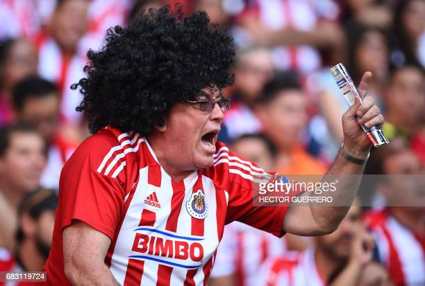 A fan of Guadalajara cheers for the team before the start of the second leg of the Mexican Clausura football tournament quarterfinal match against...