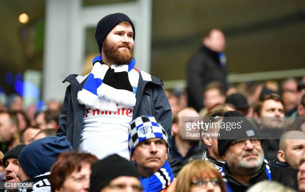 A fan of Hamburg looks disappointed during the Bundesliga match between Hamburger SV and SV Darmstadt 98 at Volksparkstadion on April 22 2017 in...