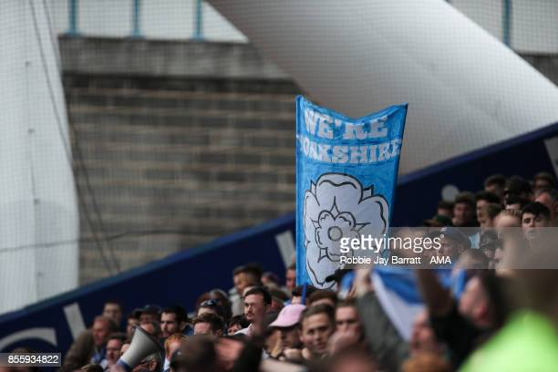 A fan of Huddersfield Town holds up a flag that reads We're Yorkshire during the Premier League match between Huddersfield Town and Tottenham Hotspur...